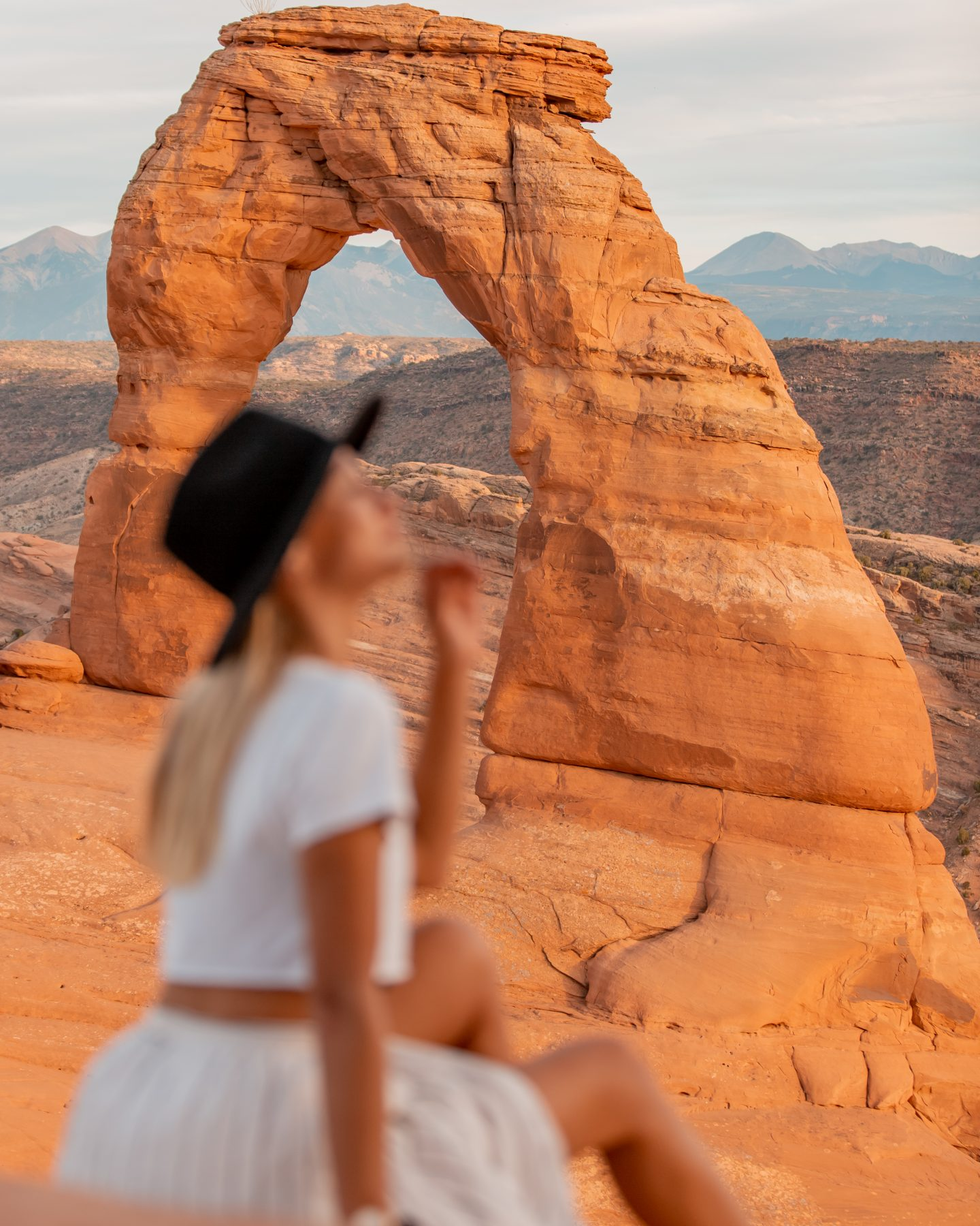 Woman at Delicate Arch in Arches National Park near Moab, Utah
