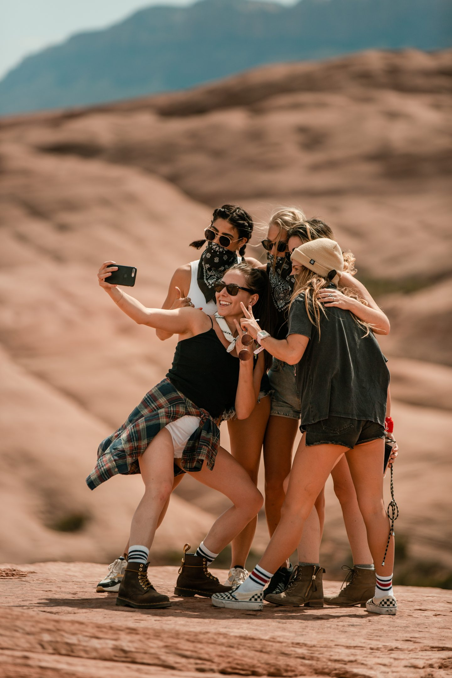 A group of women pose at Hell's Revenge in Utah