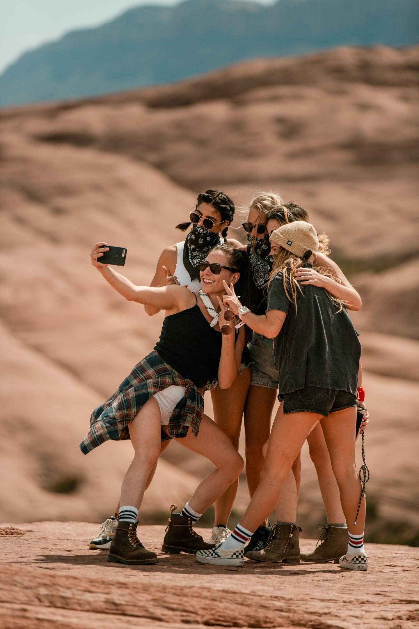 A group of women pose at Hell's Revenge in Utah