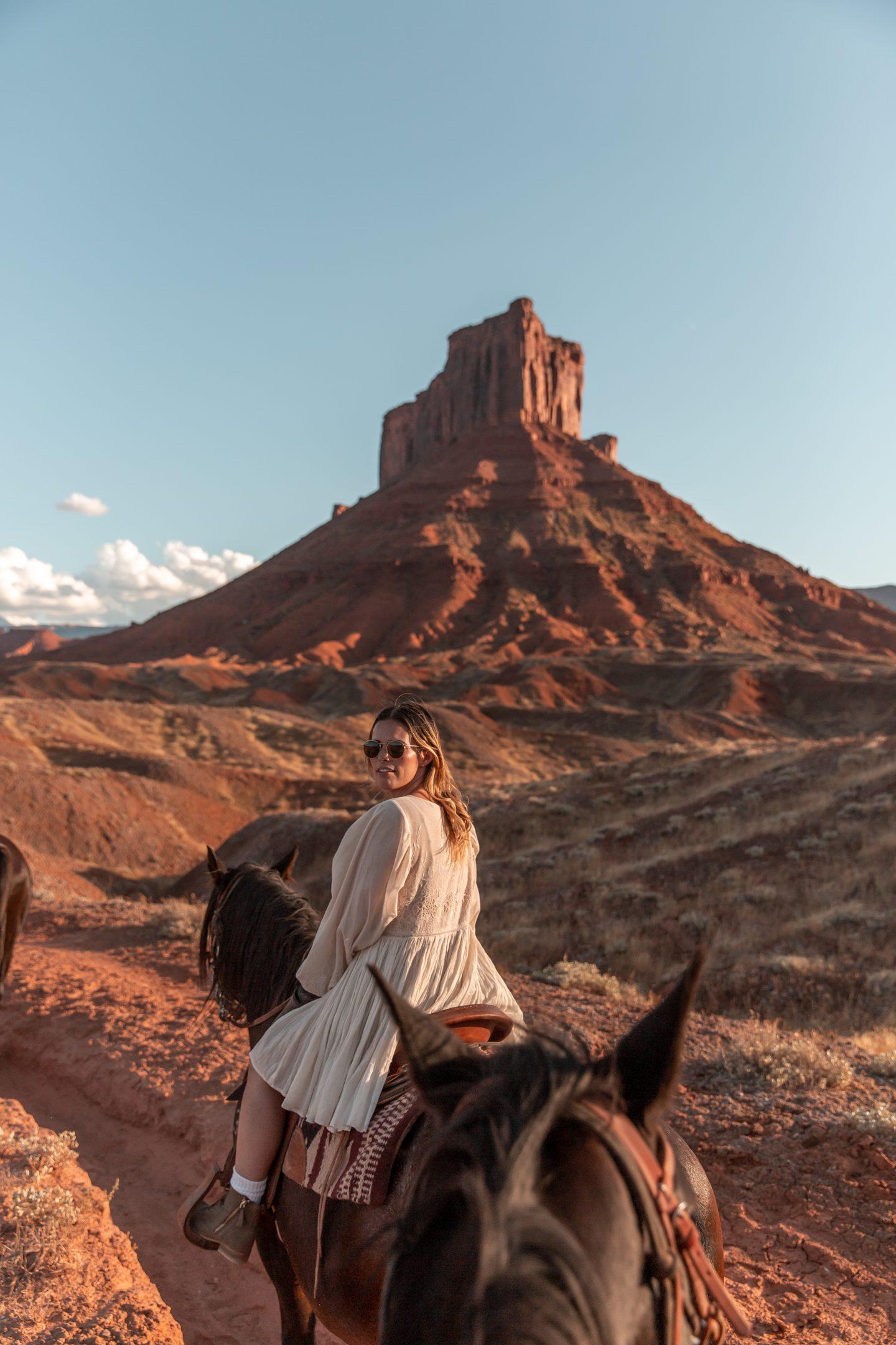 Mel Vandersluis riding a horse in Moab, Utah