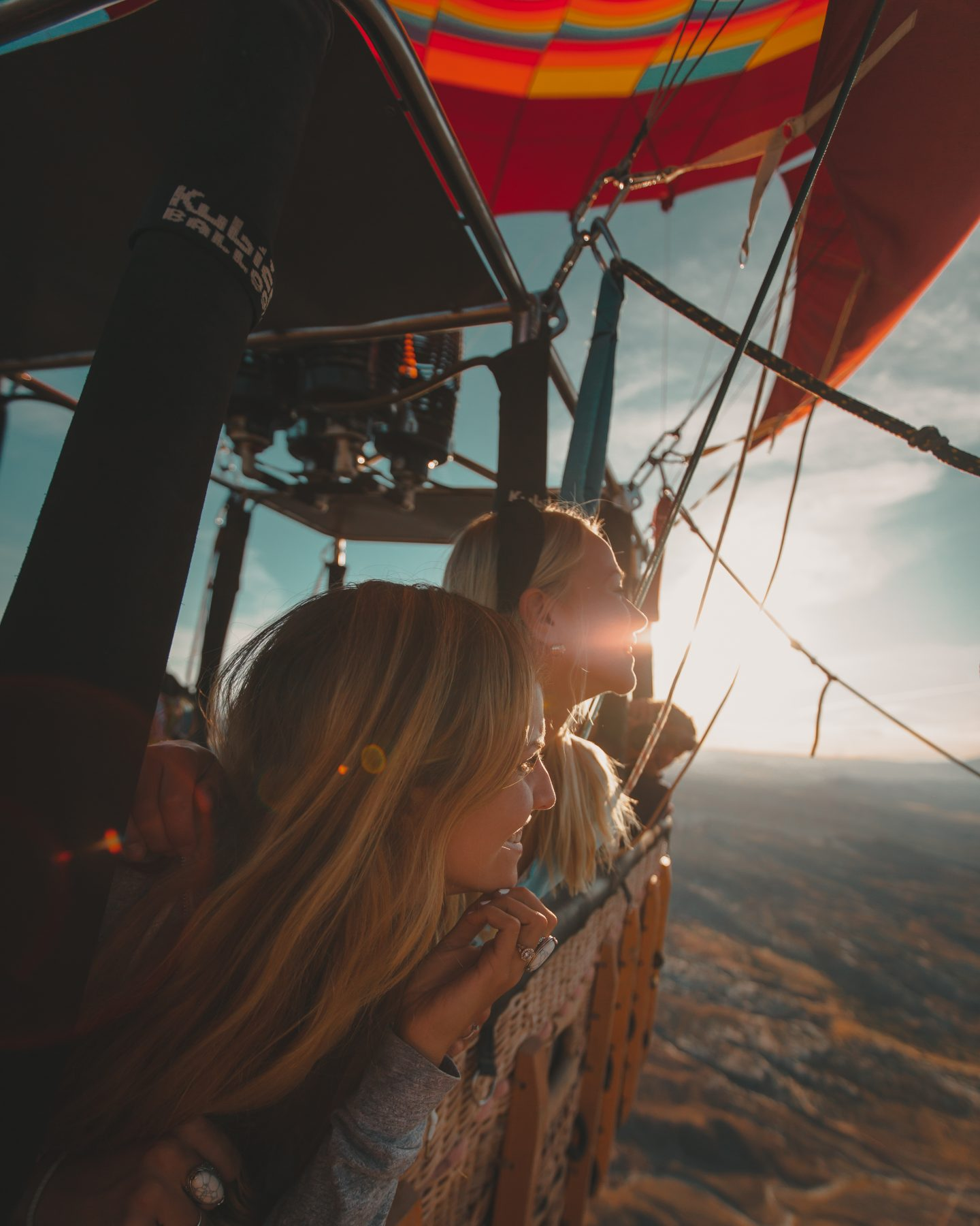 Two women look out over Moab Utah from a hot air balloon ride