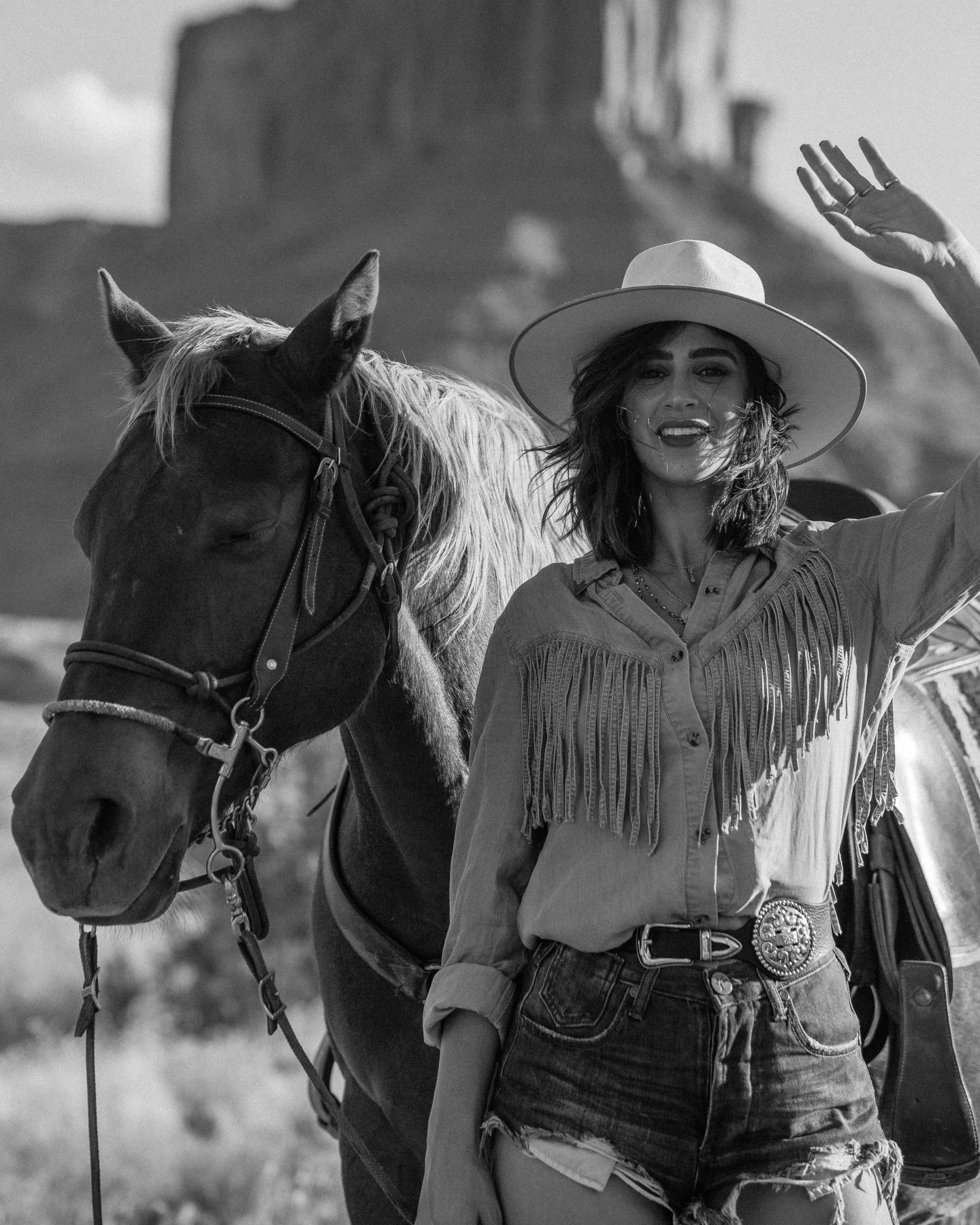 Lisa Homsy poses with a horse in Moab Utah