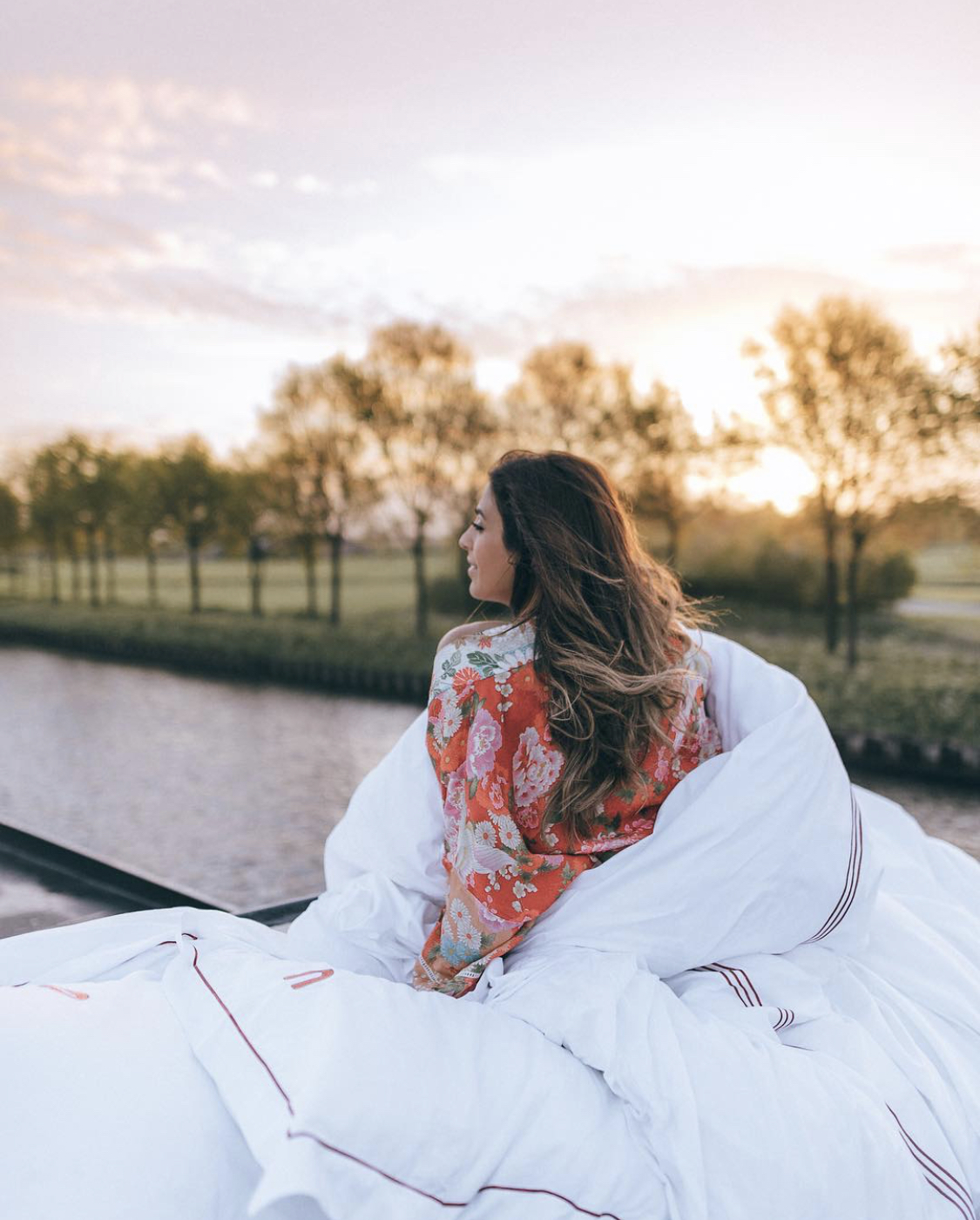 Woman waking up on a riverboat cruise in Amsterdam