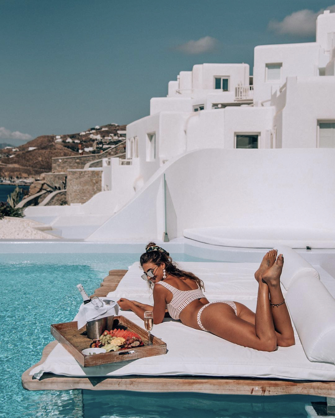 Lisa Homsy in Greece with a pool breakfast