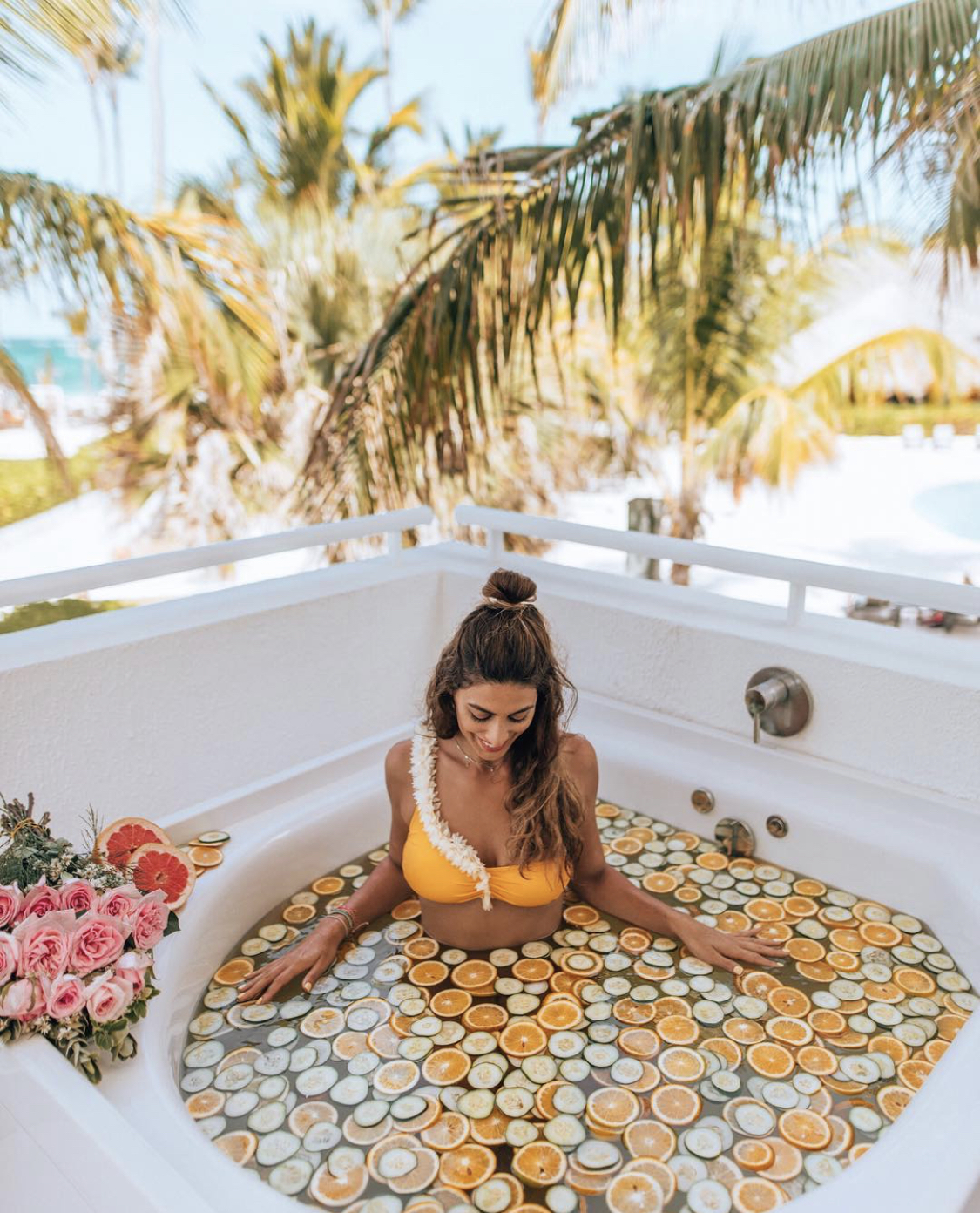 Lisa Homsy in a fruit bath in Punta Cana, Dominican Republic