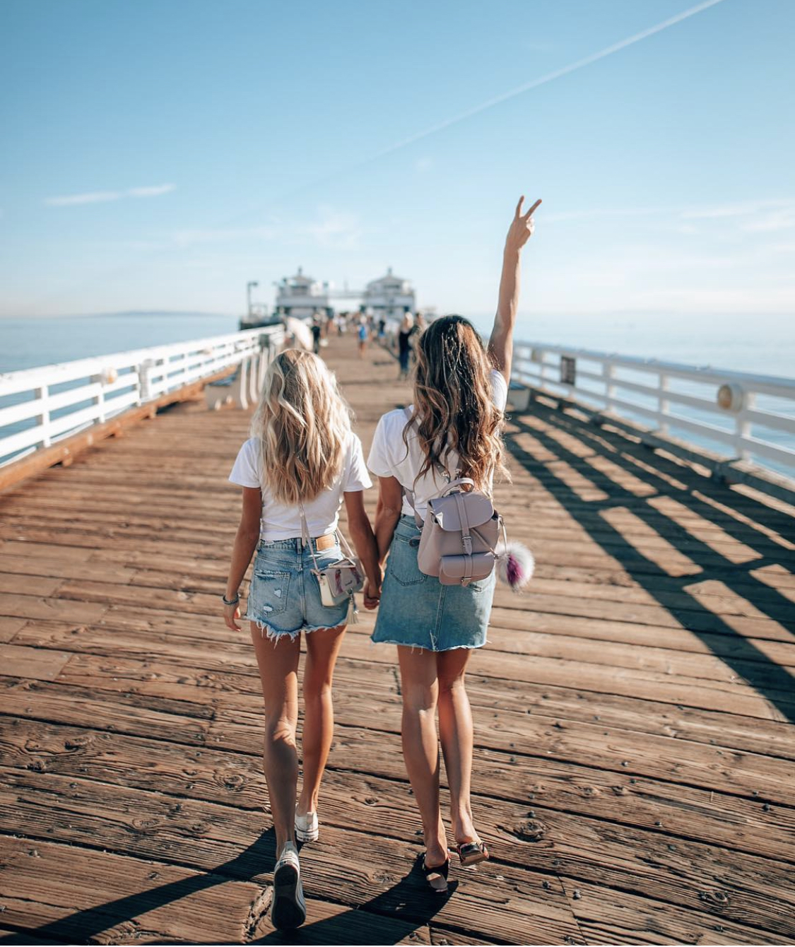 Lisa Homsy and Aggie Lal, top female travel influencers on Instagram, on Malibu Pier in Malibu, California