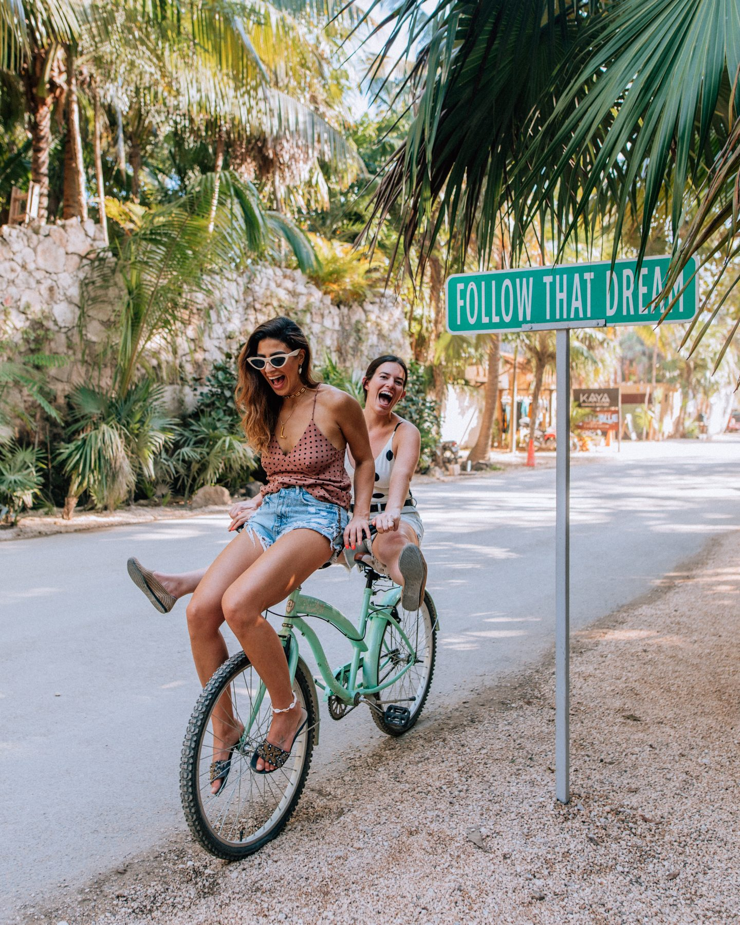 Girls trip in Tulum at the Follow That Dream sign