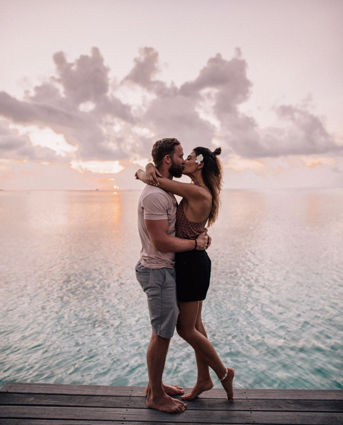 Couple kissing at sunset in the Maldives
