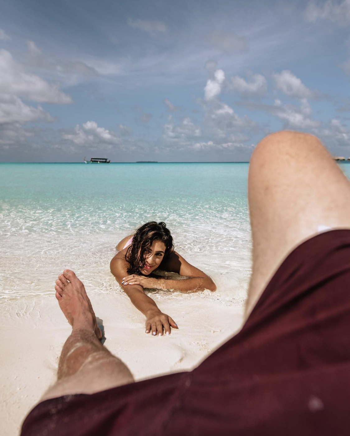 Couple relaxing on the beach in the Maldives